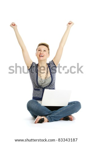 Cheering young girl using laptop isolated on white background. - stock photo