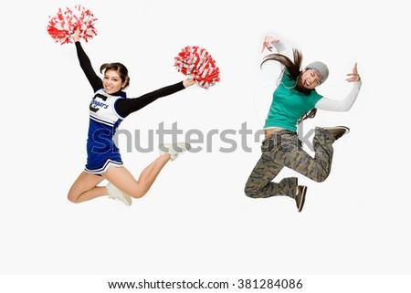 Cheerleader and skater - stock photo