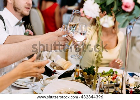 Cheers of the guests on the wedding celebration