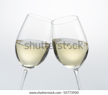 Cheers ! White Wine - stock photo