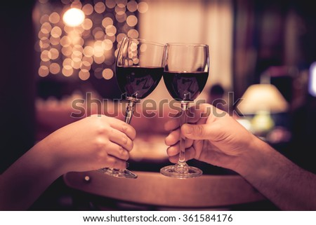 Cheers with glasses of red wine - stock photo