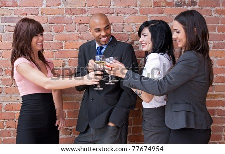 Cheers! Young people drinking wine, chatting and having fun. - stock photo