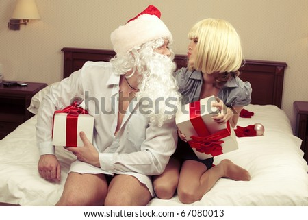Cheery party of pretty girl with Santa Claus - stock photo