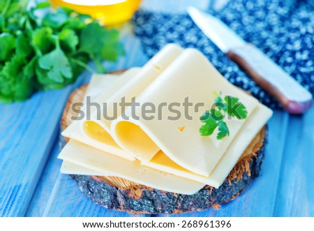 cheese and fresh parsley on a table - stock photo
