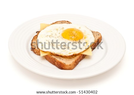 cheese and fried egg on a toast - stock photo