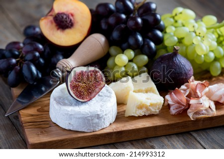 Cheese and fruits - stock photo