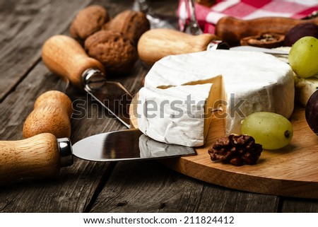 cheese and serving knifes closeup - stock photo