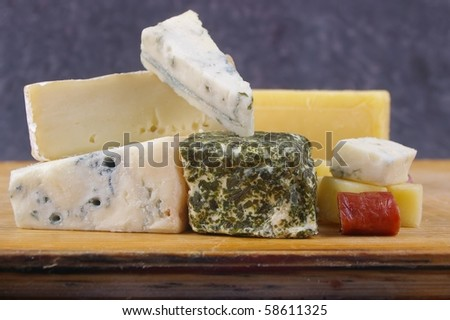 cheese antipasto varieties on wooden chopping board