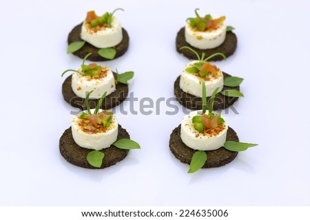 Cheese appetizers on rye bread - stock photo