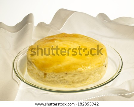 Cheese Baked Cake with apricot jam and raisins, on a white background