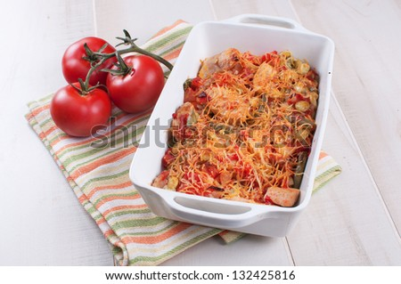 Cheese bakes vegetables and poultry casserole with tomatoes - stock photo