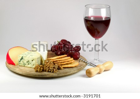 Cheese board and a glass of red wine.