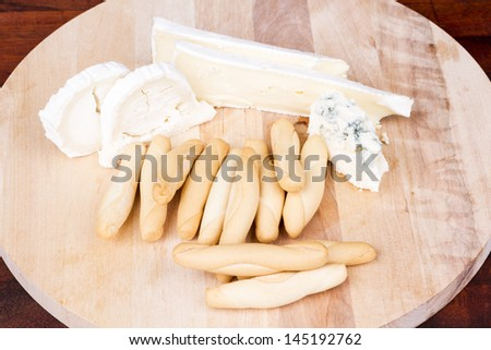 Cheese board and breadsticks