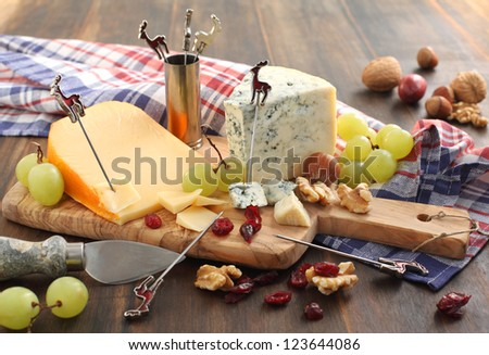 Cheese board with grape, dried cranberry and nuts - stock photo