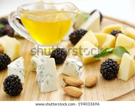Cheese board with honey - stock photo