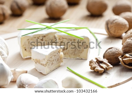 cheese brie filled with cheese mixture of chopped walnuts and garlic