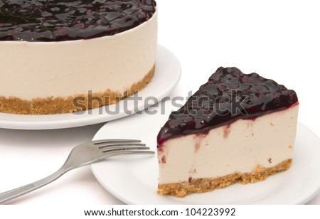 cheese cakes with blue berry on top, one small piece & one whole cake - stock photo