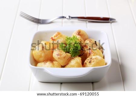 Cheese coated potatoes - stock photo
