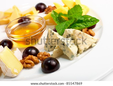 cheese collection with Camembert, Roquefort, Edam, Parmesan on the plate - stock photo