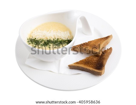 Cheese cream soup with herbs and roasted toasts. Isolated on a white background. - stock photo