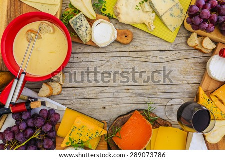 Cheese, fondue cheese - different types of cheese on a wooden background - stock photo