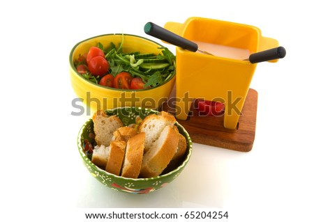 Cheese fondue with salad and bread isolated over white - stock photo