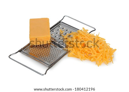 Cheese grater and cheese on white background - stock photo