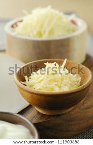 cheese in a wooden bowl - stock photo