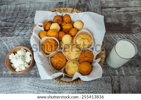 Cheese muffins with milk for dinner - stock photo