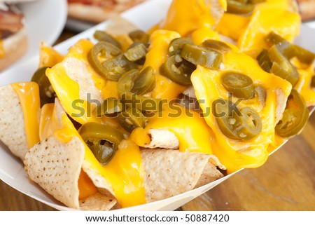 Cheese Nachos with Jalapenos - stock photo