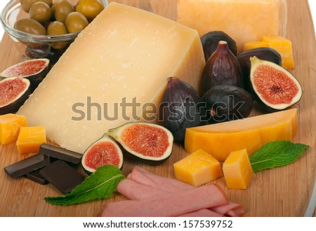 Cheese, olives, figs - stock photo