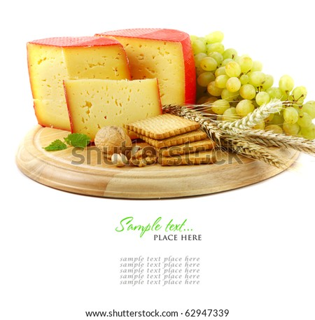 Cheese on a wooden plate with bread. Shallow DOF - stock photo