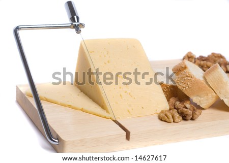 Cheese on board with bread and walnuts - stock photo