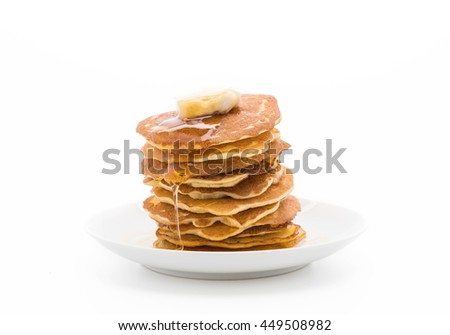 cheese on pancake stack with honey on white background
