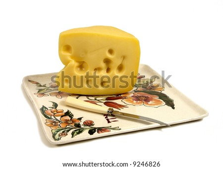 cheese on the ceramic plate whith knife on the white background - stock photo