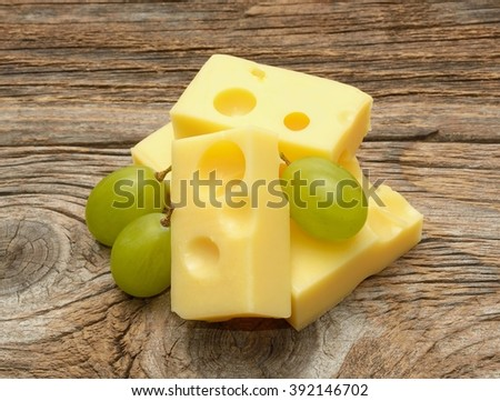 Cheese on wooden table - stock photo