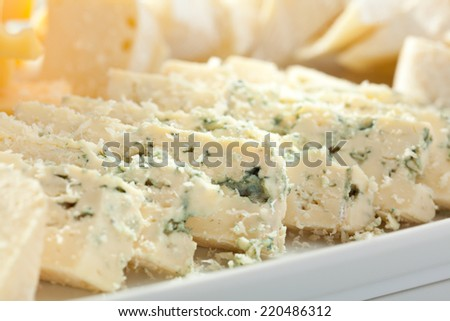 Cheese Plate with Grapes, Nuts and Honey - stock photo