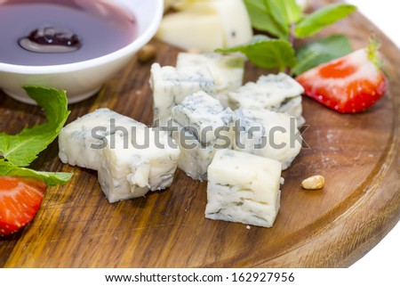 cheese plate, with several kinds of cheese on a white background - stock photo