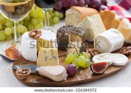 cheese platter, snacks and wine, horizontal - stock photo