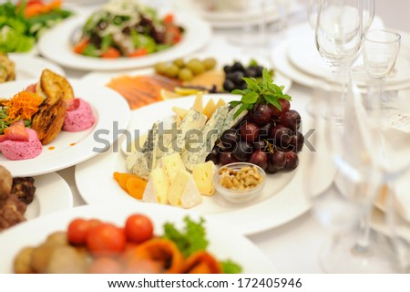 cheese platter with fruits and nuts