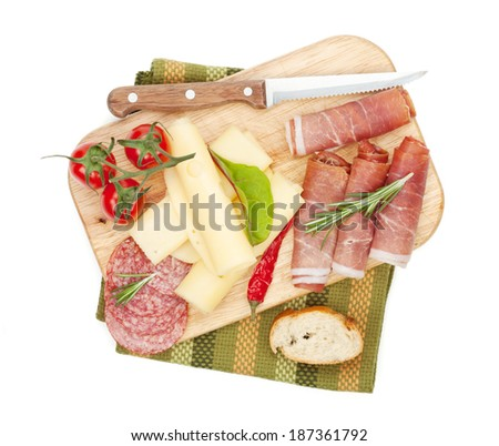 Cheese, prosciutto, bread, vegetables and spices. Isolated on white background - stock photo