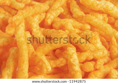 Cheese Puff Snacks laid out as a background - stock photo