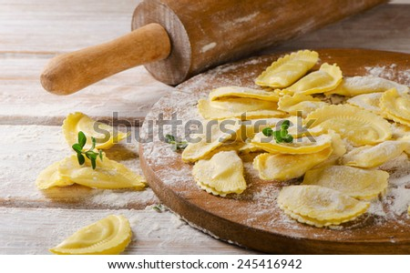 cheese ravioli on a cutting board. Selective focus - stock photo