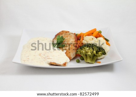 cheese sauce with meat and vegetables on white plate isolated on white background - stock photo