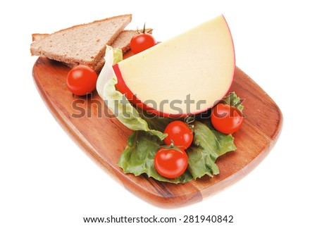 cheese served on wood with bread and salad - stock photo