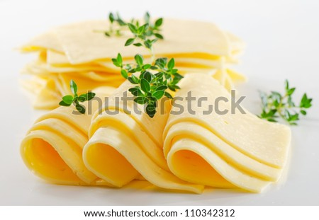 Cheese slices with fresh herbs - stock photo