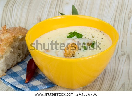 Cheese soup with croutons, herbs and spices
