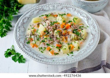 Cheese soup with vegetables and minced meat