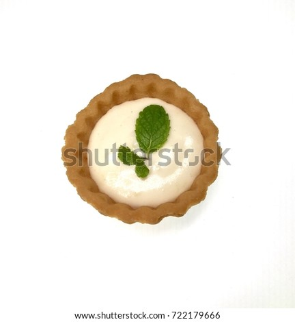 Cheese tart with mint leaf