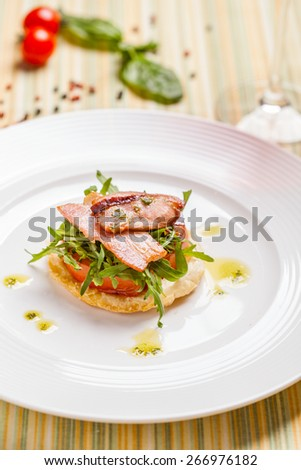 Cheese tart with tomato and bacon - stock photo